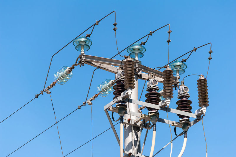Low Angle View Of Power Line Against Clear Sky