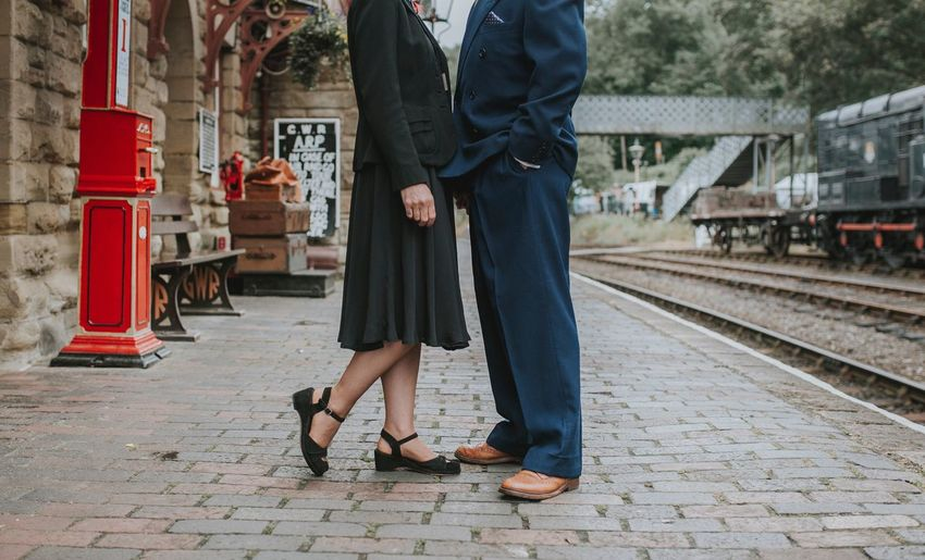 Couple standing on railway platform