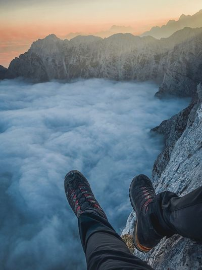 Above the clouds Winter Human Body Part Beauty In Nature Mountain Personal Perspective Human Leg Nature Scenics - Nature One Person Cold Temperature Snow Real People Low Section Body Part Leisure Activity Landscape Sky Lifestyles Environment Mountain Range
