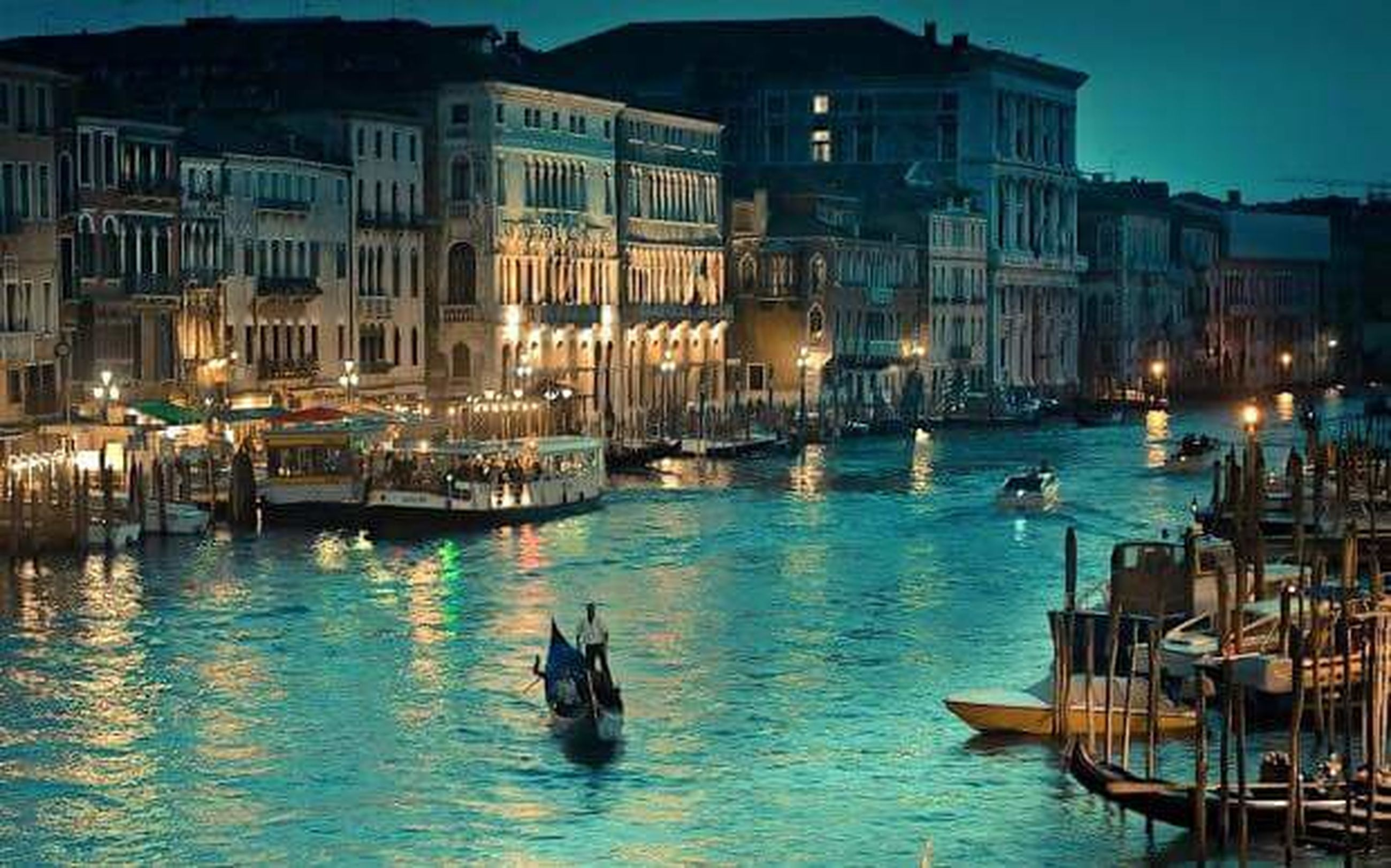building exterior, architecture, built structure, illuminated, transportation, water, nautical vessel, city, canal, mode of transport, boat, waterfront, travel destinations, residential building, night, city life, glowing, sea, tourism, sky, building story, outdoors, dock