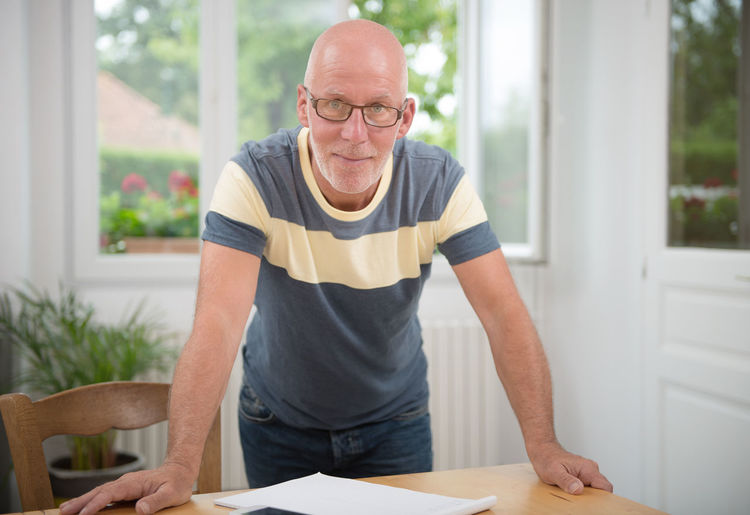 Portrait Of Mature Man Standing At Home
