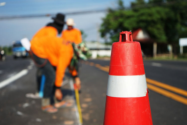 Traffic cones on road in city