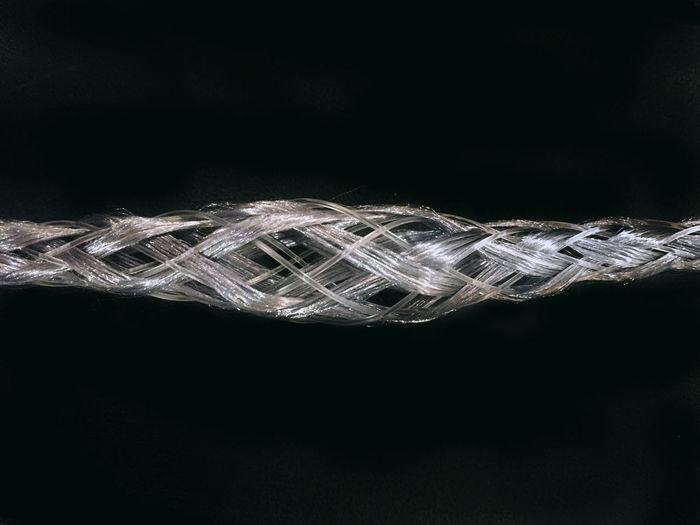 Close-up of spiral black background