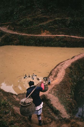 High angle view of people photographing water on land