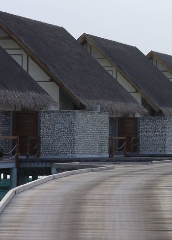 Architecture Built Structure Exceptional Photographs EyeEm Best Shots Getting Inspired Hello World In A Row Maldives No People Outdoors Roof Sky Taking Photos Thatched Roof The Way Forward Travel Vacation Wall Watervillage Wodden Texture Wooden Bridge Adapted To The City