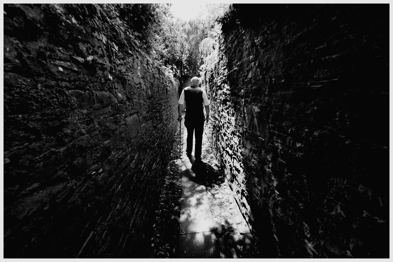 Walking Real People Day Full Length One Person Rear View Men Lifestyles Outdoors Forfar Scotland Tourism Attractions Scenic Beauty High Stone Narrow Wall Black And White Photography