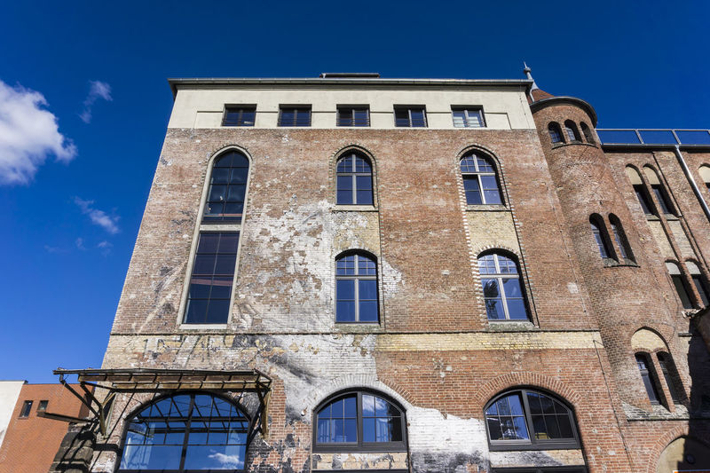 Old refurbished factory building in Berlin, Germany Architecture Berlin Blue Sky Bricks Building Exterior City Clock Day Factory Building Germany History Horizontal Low Angle View No People Office Building Outdoors Photography Refurbished Sky Unrecognizable People Windows