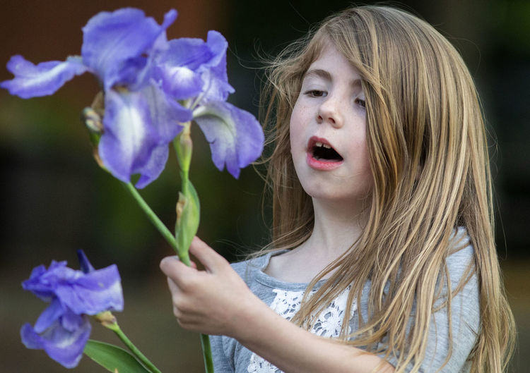 A seven-year-old girl looks at a blooming tulip in evening light. Flower Flowering Plant Real People Headshot Plant Portrait Vulnerability  Fragility Leisure Activity Beauty In Nature Petal One Person Women Girls Freshness Lifestyles Child Hair Focus On Foreground Flower Head Hairstyle Outdoors Teenager Innocence Pre-adolescent Child Girl Happiness Curiousity Curious Tulip Tulips Long Hair Childhood Rural Scene Rural Rural America Evening Evening Light Moment moments of happiness Flowers Plant Plants Blooming Blossom
