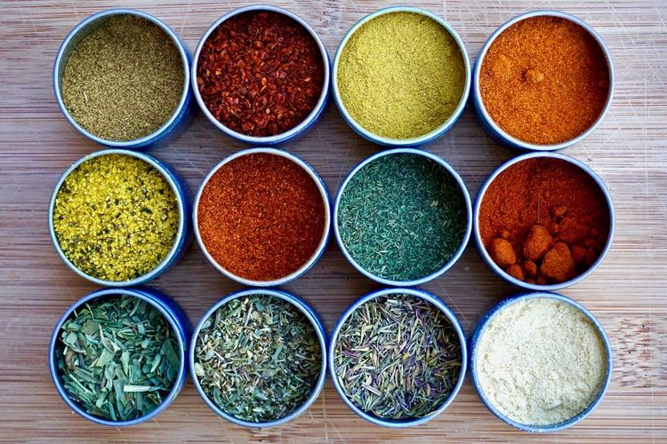 Twelve assorted spices in herbs in mini tins Arrangement Assortment Choice Cooking Spices Cumin Day Dozen Dry Mustard Food Herbs Indoors  Ingredients Lemon Pepper Seasoning Mini Tins Multi Colored No People Paprika Pattern Round Seasoning Shapes Spices Tarragon Variety Wood - Material