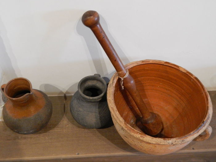 Close-up of objects on table against wall