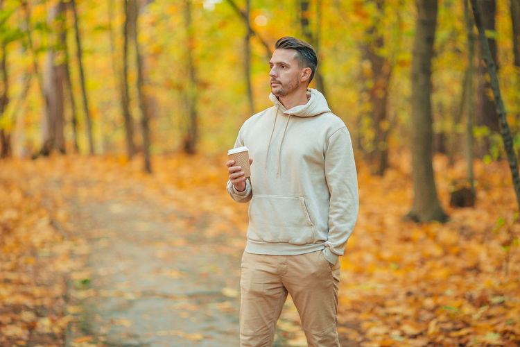 Man standing in forest during autumn