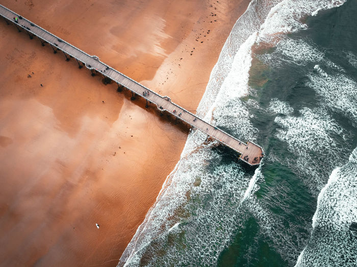 High angle view of skateboard by sea