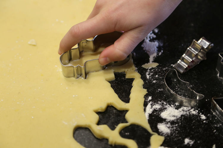 Cropped Hand Of Woman Making Cookies In Kitchen