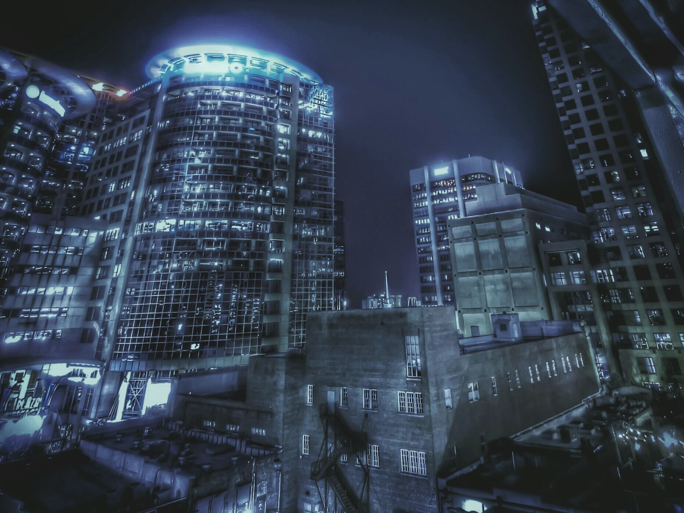 architecture, building exterior, built structure, night, illuminated, city, skyscraper, modern, tall - high, tower, office building, building, low angle view, capital cities, cityscape, no people, residential building, city life, travel destinations, sky