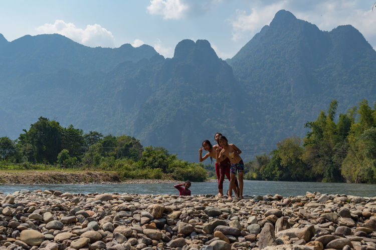 ASIA Children LAO South East Asia Travel Travel Photography Vang Vieng Vang Vieng, Laos Asian Children Children Playing Laos Laos Travel Leisure Activity Lifestyles Mountain Nature Scenics Sky Travel Asia
