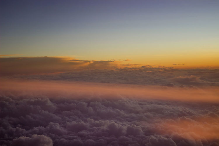 Scenic View Of Cloudscape Against Sky During Sunrise