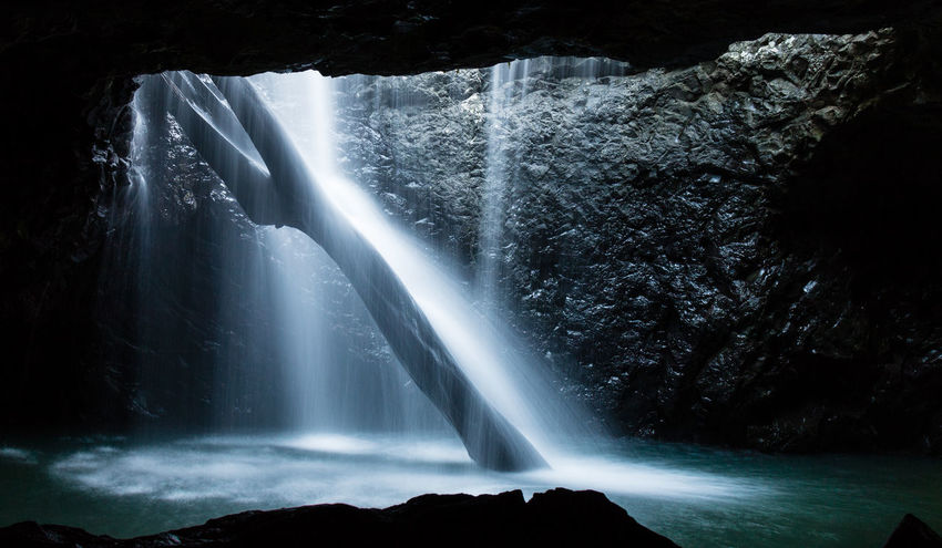 Australia Beauty In Nature Blurred Motion Cave Day Flowing Water Idyllic Long Exposure Motion Naturalbridge Nature No People Outdoors Power In Nature Queensland Scenics Spraying Springbrooknational Water Waterfall Waterfront Paradise Somewhereonlyweknow