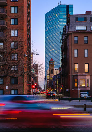 Architecture Back Bay Blue Hour Blur Blurred Motion Boston Building Exterior Built Structure City City Life Hancock Illuminated Light Light Trail Light Trails Long Exposure Motion New England  No People Outdoors Slow Slow Shutter Speed Sunset Trails