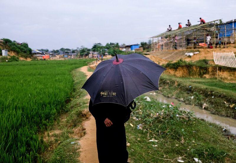 Rethink Things Photojournalist ASIA EyeEmNewHere TheWeekoneyem One Person Umbrella Paddy Field Rohingya Refugees Bangladesh 🇧🇩 Photojournalism Women EyeEm Best Shots Photography Perspectives On Nature Be. Ready.