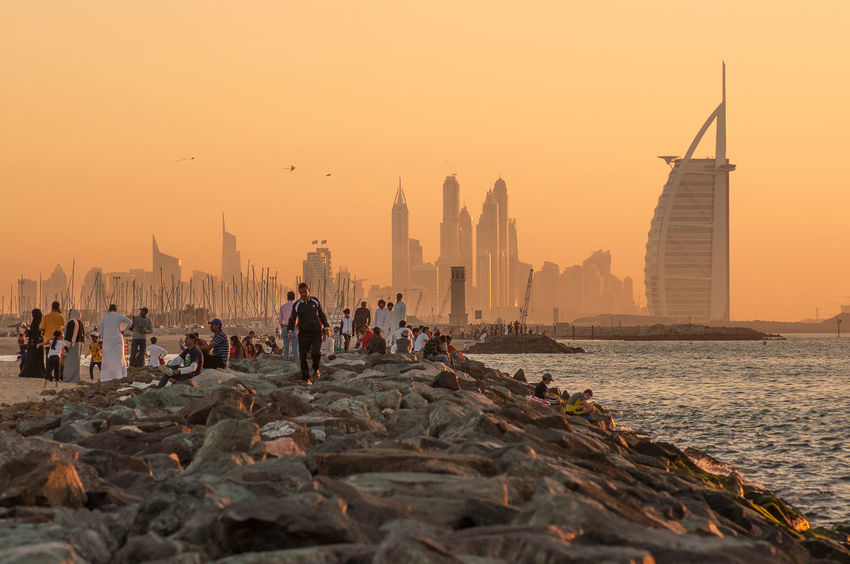 Sunset of Dubai Jumeirah Beach Architecture Building Exterior Built Structure Burj Arab Hotel Cityscape Dubai Dubai City Dubai Cityscape Dubai Sunset Dubaicity Dubai❤ Jumeirah Jumeirah Beach Jumeirahbeach Large Group Of People Outdoors Real People Sunset Tourism Travel Destinations