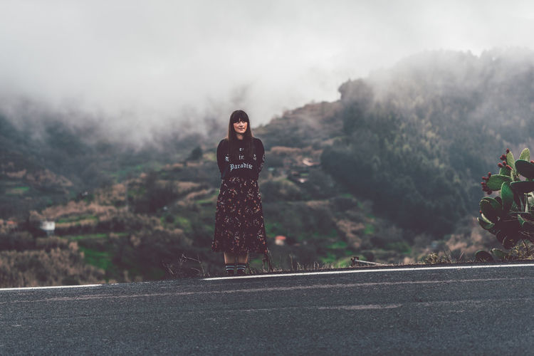 Foggy Day. Cloudy Foggy Weather Nature Wandering Wanderlust Day Fog Foggy Full Length Lifestyles Looking At Camera Mountain Nature One Person One Woman Only Outdoors People Plant Real People Road Roadside Standing Tree Young Adult Young Women Go Higher