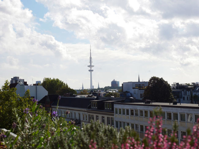 Architecture Building Exterior Built Structure City Cloud Cloud - Sky Communications Tower Day Flower Funkturm Growth Hamburg Heinrich Hertz Turm No People Outdoors Plant Sky Skyline Spire  Tall Tall - High Tower Town Tree View