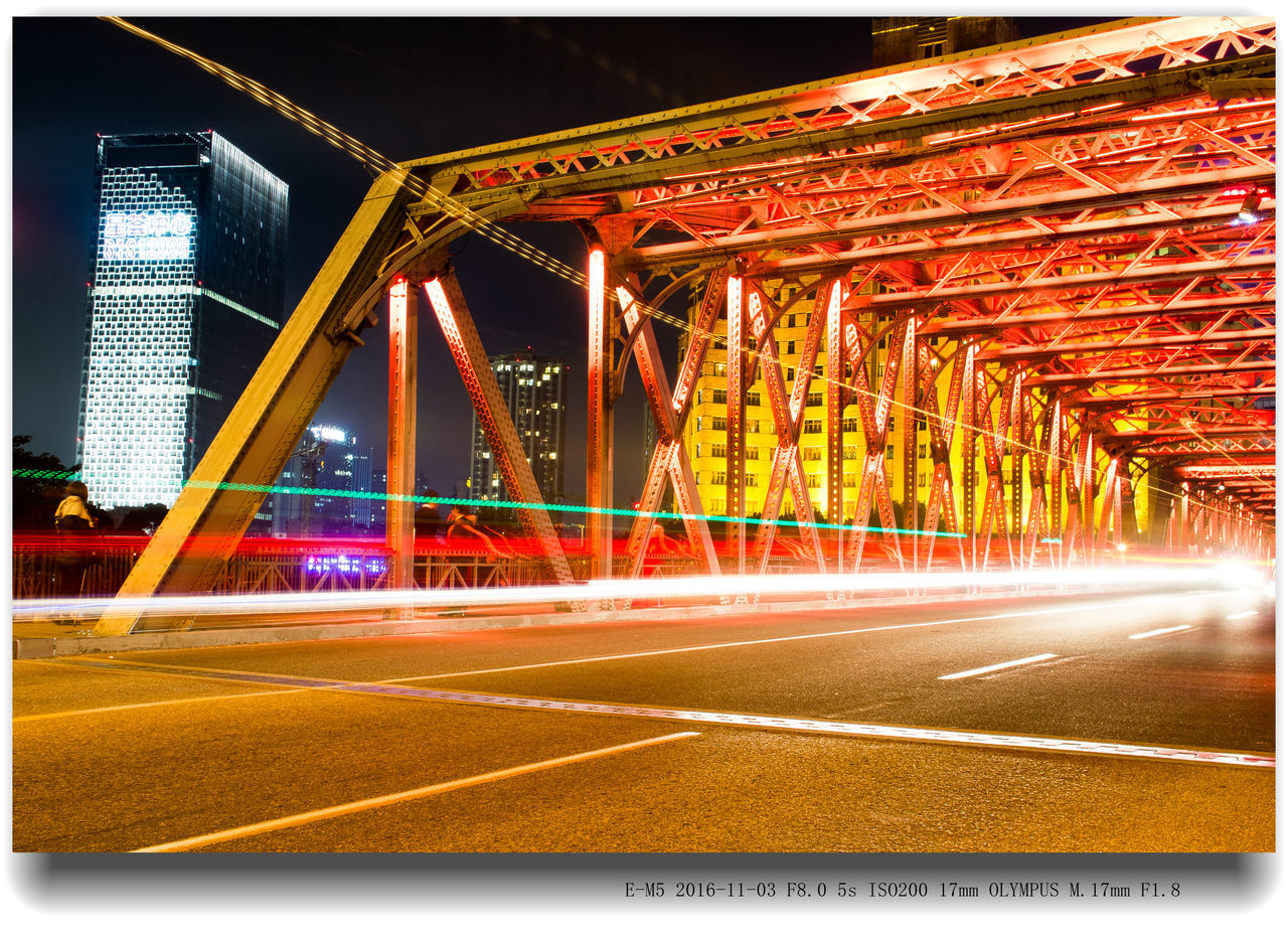 transportation, bridge - man made structure, speed, night, architecture, illuminated, long exposure, light trail, road, connection, built structure, traffic, motion, blurred motion, outdoors, no people, city