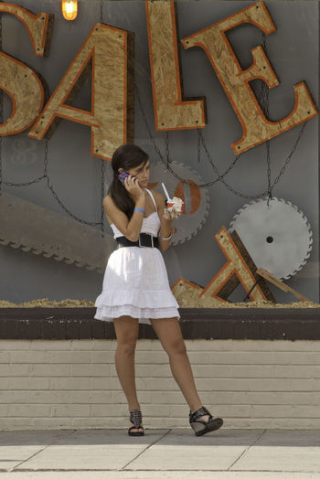 Cellphone Day Fashion Frozen Yogurt Full Length Legs On The Phone Real People Sandals Standing Streetfashion Streetphotography Wedges