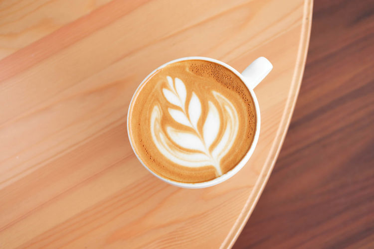 Coffee - Drink Coffee Refreshment Coffee Cup Drink Cup Mug Food And Drink Frothy Drink Cappuccino Still Life Froth Art Hot Drink Latte Wood - Material Close-up Table Creativity High Angle View No People Saucer Crockery Non-alcoholic Beverage Caffeine