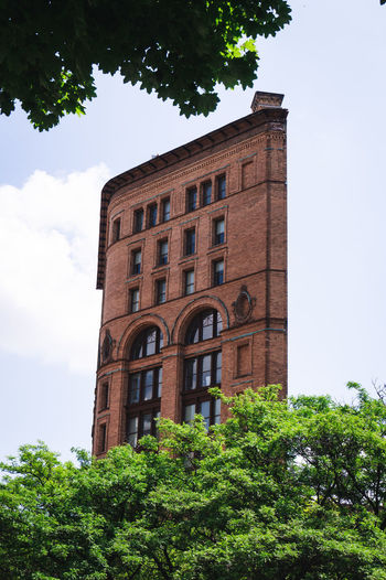 Buffalo, United States Brick Wall Buffalo United States Architecture Brick Building Brickstone Building Brickstones Building Building Exterior Built Structure City Cloud - Sky Day Green Color Growth History Low Angle View New York State No People Old Buildings Plant Sky Tower Tree Window