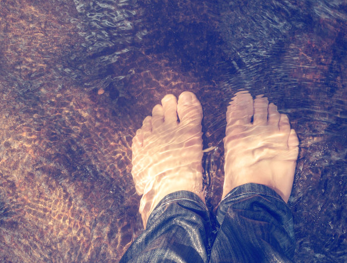 View from above of man feet underwater vintage color tone effect Body Part Human Body Part One Person Shoe Standing Directly Above Human Foot Real People High Angle View Lifestyles barefoot Nature Jeans Outdoors Water Day