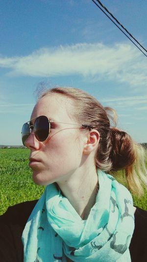 The Portraitist - 2016 EyeEm Awards Portrait Portrait Of A Woman Woman Girl Portrait Of A Girl Blonde Blonde Girl Blonde Hair Sunglasses Reflection Sunglasses Reflection Sunny Sunny Day Cloud Grass Field Piercing Industrial Piercing Ear Piercing Scarf