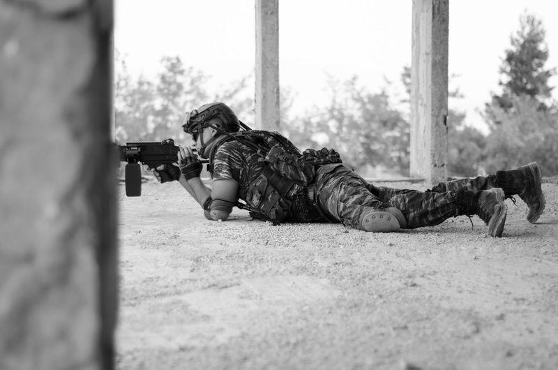 Man shooting a gun on floor
