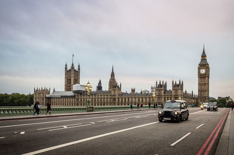 Westminster bridge a cloudy day Architecture Brexit Building Exterior City Cityscape Clock Clock Tower Cloud - Sky Cloudy Day England Government London London Lifestyle No People Outdoors Politics And Government Road Sky Tower Traffic Transportation Travel Destinations Urban Skyline Westminster Bridge