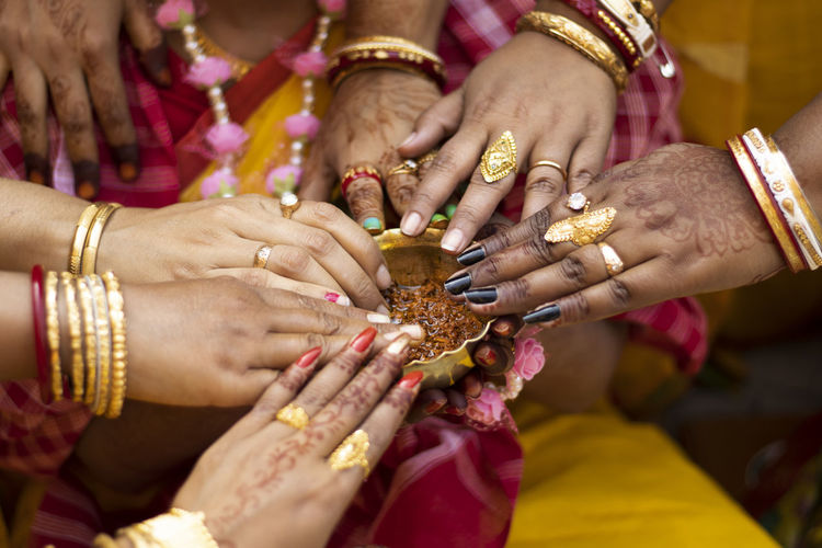 Cropped image of women during wedding ceremony