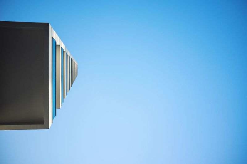 Blue Clear Sky Copy Space Sky Low Angle View No People Architecture Wall - Building Feature Textile Outdoors Building Sunlight Nature Close-up Hanging Sunny Building Exterior Day Built Structure Blue Background