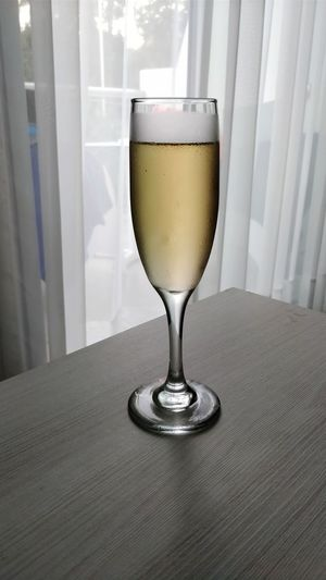 Close-up of champagne in glass on table