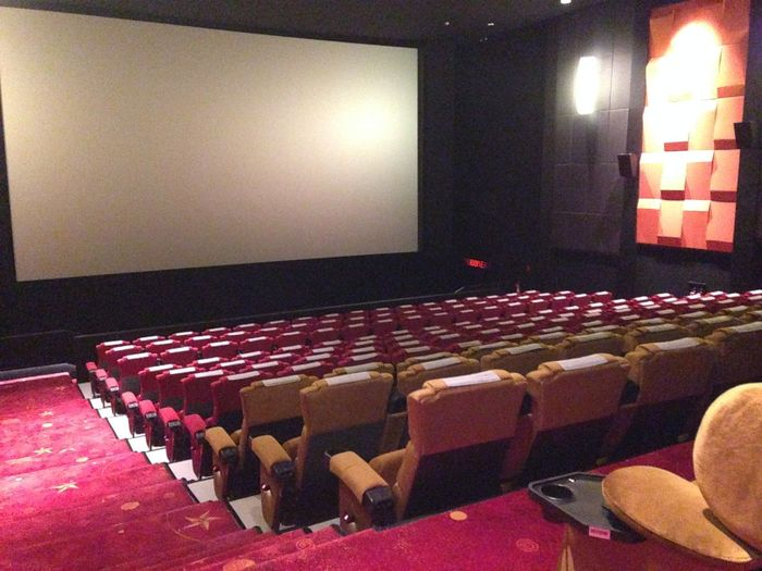 Arts Culture And Entertainment Auditorium Cinema Film Industry High Angle View Illuminated In A Row Indoors  Large Group Of Objects MOVIE Movie Theater No People Projection Screen Red Seat Theater