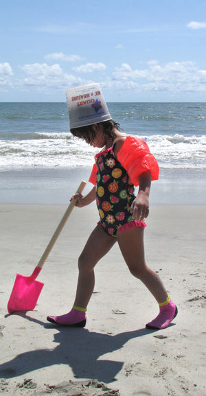 Young girl on a beach, with shovel and bucket Beach Beauty In Nature Childhood Day Full Length Girl Holding Horizon Over Water Leisure Activity Lifestyles Nature One Person Outdoors People Real People Sand Sea Shadow Sky Standing Summer Sunlight Vacations Water Wave