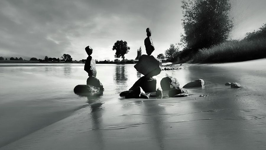 Stacked stones at lakeshore