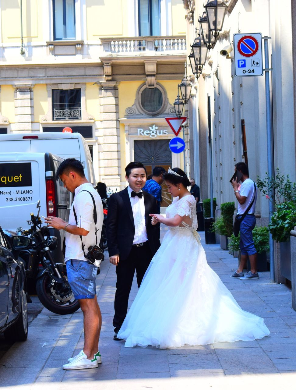 full length, real people, men, bride, wedding, walking, women, architecture, built structure, wedding dress, standing, day, togetherness, bridegroom, young women, well-dressed, young adult, building exterior, outdoors, groom, adult