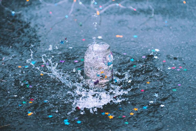 Water splashing in jar on street during rainy season