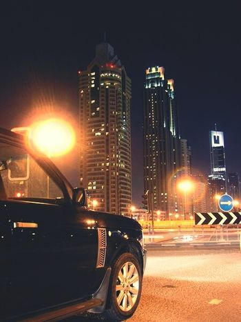 Car City Night Transportation Illuminated Street Light Luxury City Life Building Exterior Skyscraper Outdoors Modern Driving Cold Temperature Downtown District Urban Skyline Road No People Architecture Dubai EyeEmNewHere WhileIAmOnMove Dubailife Rangerover