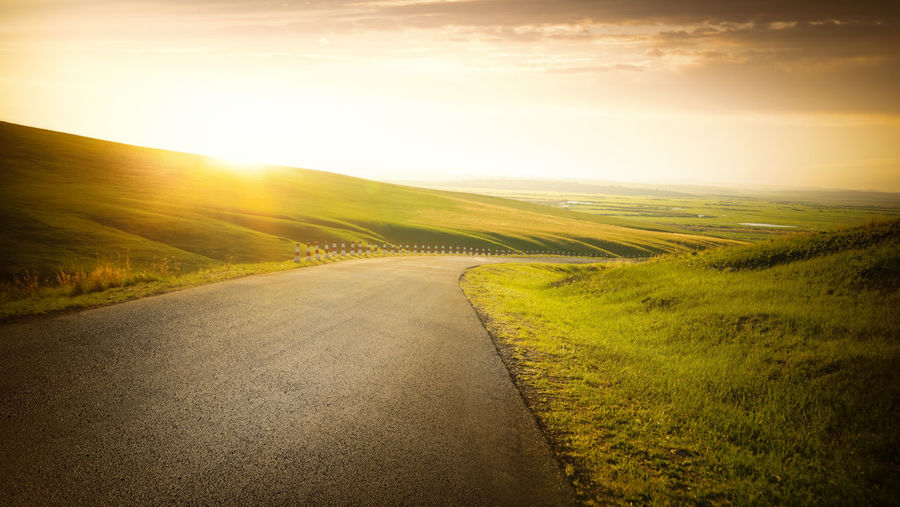 Beauty In Nature Country Country Road Direction Environment Grass Horizon Landscape Lens Flare Nature No People Outdoors Road Rural Scene Scenics - Nature Sky Sun Sunlight Sunset The Way Forward Tranquil Scene Tranquility Transportation