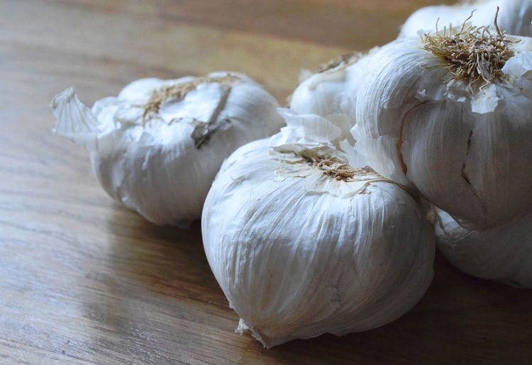 Garlic bulbs. Garlic Close-up Focus On Foreground Food Food And Drink Freshness Garlic Garlic Bulb Garlic Bulbs Garlic Clove Group Of Objects Healthy Eating Indoors  Ingredient No People Raw Food Spice Still Life Table Vegetable Vegetarian Food Wellbeing White Color Wood - Material