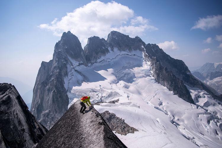Young man climbing mountain during winter
