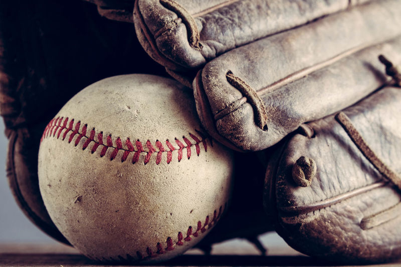 Close-up of baseball glove and ball on table