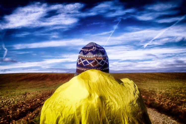 Someone walks in the middle of nothing Activities Air Backpack Blue Camino Cold Fresh Colorful Vivid Countryside Daylight Forward Hat Health Hiking Lifestyle Nature Non-urban Outdoor Rural Sky Sport Walking Yellow