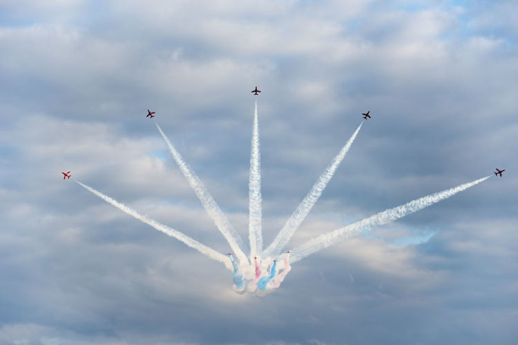 Red Arrows starburst Aerobatics Airplane Airshow Flying Formation Flying Mid-air Multi Colored Vapor Trail