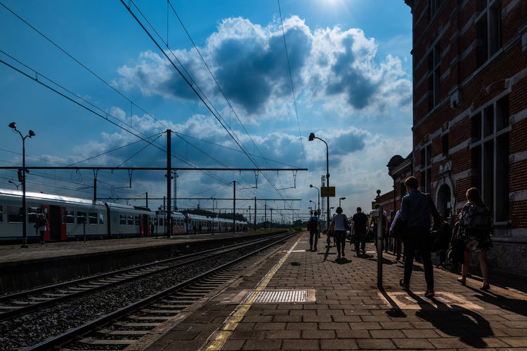 End of afternoon Built Structure City Cloud - Sky Group Of People Mode Of Transportation People Public Transportation Rail Transportation Railroad Track Real People Sky Sunlight Track Transportation